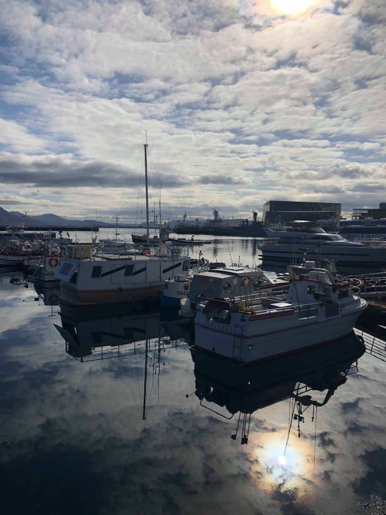 Boats in the old harbour and Harpa concert hall in the background