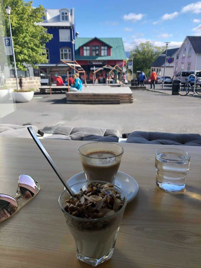 A latte, yoghurt with granola and honey at Reykjavik Roasters