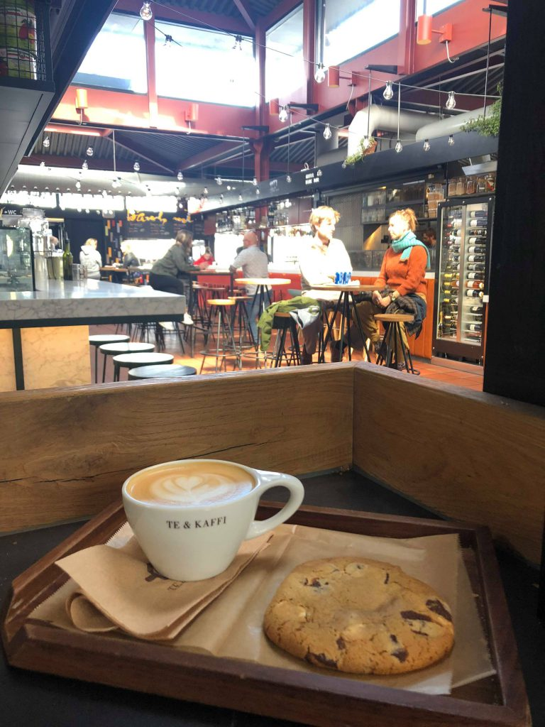 The industrial interior inside of Hlemmur food court and a latte & cookie from Te & Kaffi